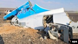Debris from the ill-fated Metrojet Airbus lies strewn across the sand at the crash site on the Sinai Peninsula.