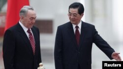 Kazakh President Nursultan Nazarbaev (left) visited his Chinese counterpart Hu Jintao in Beijing in February.