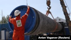 A worker puts a cap on a pipe at aconstruction sitefor the NordStream2 gas pipeline in the Leningrad region earlier this year.