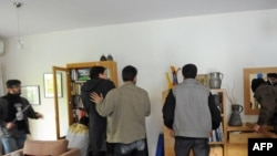 Iran -- Protesters search an office at the British embassy in Tehran, 29Nov2011