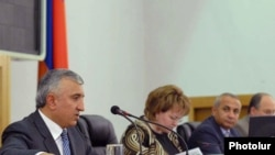 Armenian Justice Minister Gevorg Danielian (left) presents an amnesty bill in parliament in June of last year.