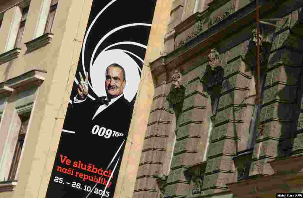 "A campaign banner in Prague reading ""In the service of our country"" and featuring the chairman of the center-right Top 09 party, Karel Schwarzenberg; it mimicks a look from the 007-James Bond films."