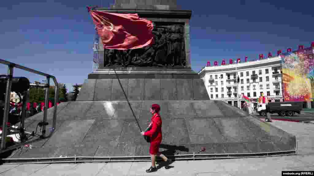 A Belarusian child flies the flag of the former Soviet Union during Victory Day celebrations in Minsk.