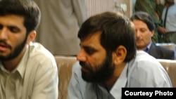 دو تن از متهمان قتل های محفلی در کرمان در سال ۱۳۸۱.