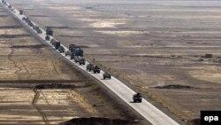 Североатлантический альянс давно перерос узкие географические рамки (на снимке: британский военный конвой в афганском Гельменде). Но зафиксировать на бумаге глобальные функции союза пока не удается
