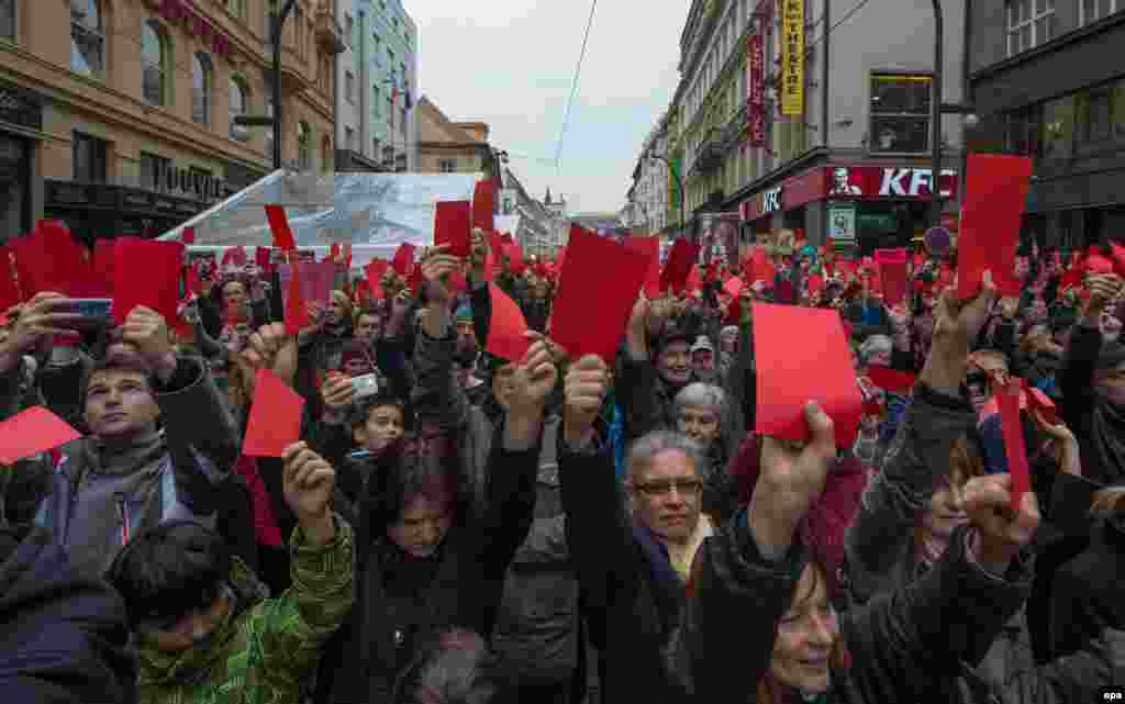 Czech Republic -- Protesters show symbolical red cards during a prostest against Czech President Milos Zeman in Prague, Czech Republic 17 November 2014.