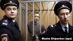 Bolshoi Ballet dancer Pavel Dmitrichenko is seen in the defendant's cage during a court hearing in Moscow on October 22.