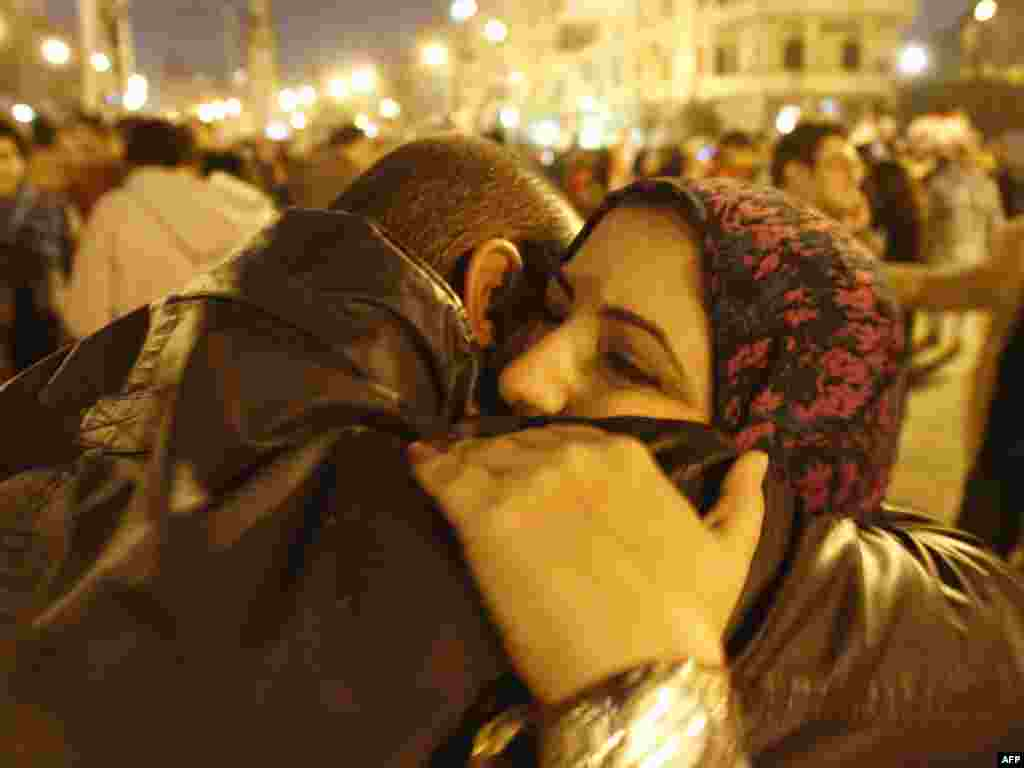 Antigovernment protesters celebrate outside the presidential palace in Cairo after Mubarak resigns on February 11.