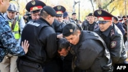 Kazakh police detain anti-government protesters in Almaty in October.