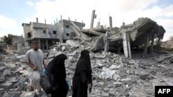 Палестинці повертаються до розбомблених будинків, 4 серпня 2014