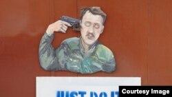 Faimoasa instalaţie cu Igor Strelkov, la Doneţk, realizată Serghei Zaharov