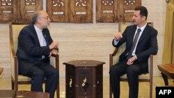 Переговоры Башара Асада (справа) и Али Акбара Салехи
