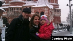Kendra Skaggs and her husband, Jason, pose on Red Square with 5-year-old Polina, now known as Polly.