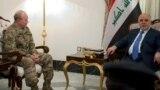 العبادي يلتقي ديمبسي خلال زيارته إلى بغداد في 9 آذار 2015
