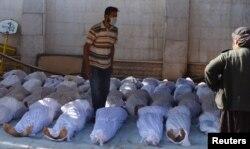 Тіла загиблих під час інциденту в околицях Дамаска, 21 серпня 2013 року