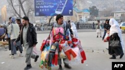 People have been going about their daily business in Kabul despite security warnings from the authorities.