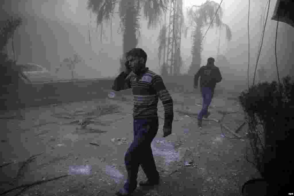 """Фотография Самира Аль-Доуми, победителя в категории """"Фотография с места события"""". Сирия, город Хамурия после бомбардировок."""