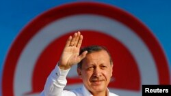 Turkey -- Turkey's Prime Minister and presidential candidate Tayyip Erdogan greets his supporters during an election rally in Istanbul August 3, 2014.