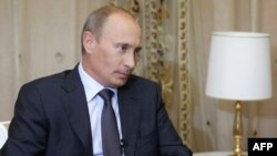 Russian Prime Minister Vladimir Putin gives an interview to Abkhaz media in Sochi on August 12 ahead of his trip.