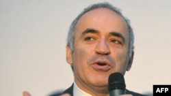 Garry Kasparov fled to the United States after he was detained by Russian police at a 2012 rally in support of the punk art collective Pussy Riot, three of whose female members were on trial for an anti-Kremlin disturbance at the time.