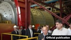 Armenia - Prime Minister Tigran Sarkisian (R) visits a metallurgical enterprise in Kajaran, 10Sept2011.
