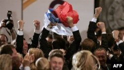 The Russian delegation cheers Sochi's selection in July 2007 to host the 2014 Winter Olympics.