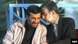 Iran -- President Mahmud Ahmadinejad (L) with Parliament Speaker Gholam Ali Haddad-Adel in Tehran, 04Jun2007