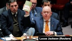 "U.S. -- Russian Ambassador to the United Nations (U.N.) Vasily Nebenzya quotes from of ""Alice's Adventures in Wonderland and Through the Looking Glass"" as he speaks regarding an incident in Salisbury, Britain, during a meeting of the U.N. Security Council"
