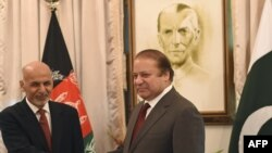 Afghan President Ashraf Ghani (L) and Pakistani Prime Minister Nawaz Sharif shake hands in Islamabad on November 15, 2014.