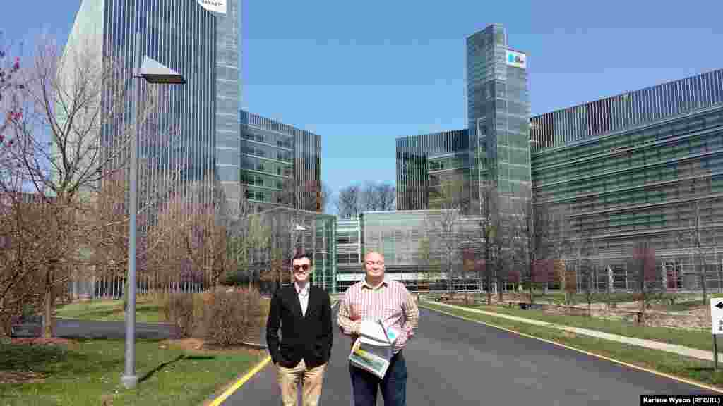 "Beliaev (r) and Gabidullin outside of ""USA Today's"" headquarters in McLean, Virginia."