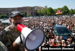 Armenian opposition leader Nikol Pashinian addresses supporters during a rally in Yerevan on April 25.