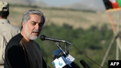Afghan presidential candidate Abdullah Abdullah addresses supporters during an election campaign rally in the Paghman district of Kabul Province on June 9.