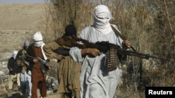 Taliban fighters pose with their weapons in Afghanistan's Nangarhar Province. (file photo)