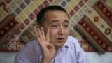 Kazakhstan - In this March 29, 2018, photo, Serikzhan Bilash, a prominent activist campaigning against Chinese internment camps, gestures as he speaks to The Associated Press at a restaurant in Almaty, Kazakhstan. Bilash was arrested by Kazakh police at a