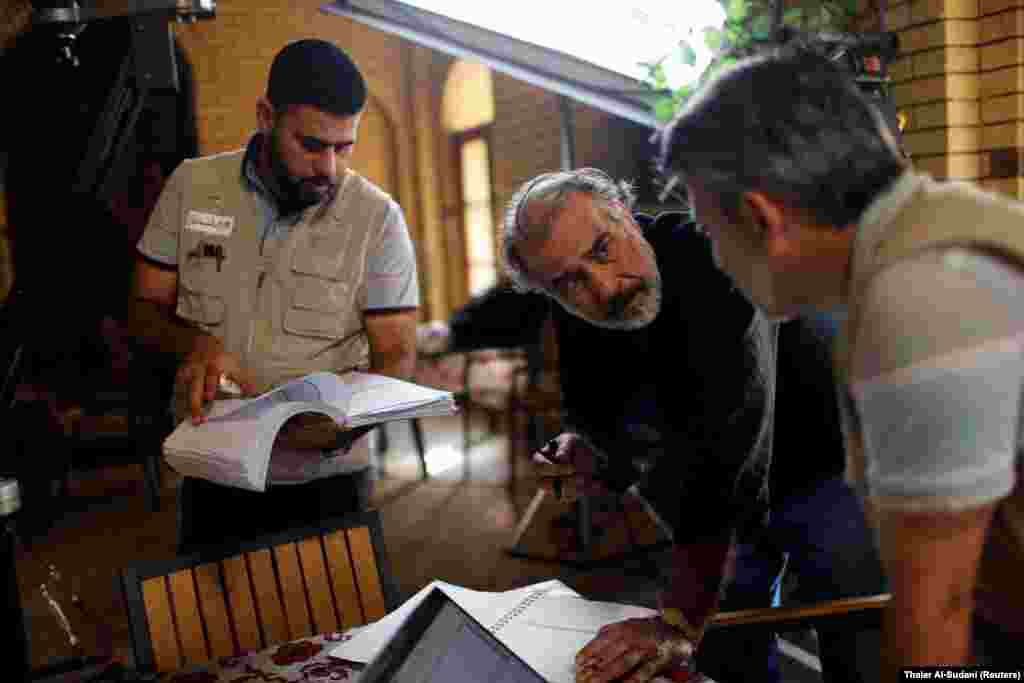IRAQ - Director Hassan Husni speaks to the director of photography while filming the hotel TV series, which is being filmed and broadcast during the Muslim holy month of Ramadan, in Baghdad, Iraq May 12, 2019