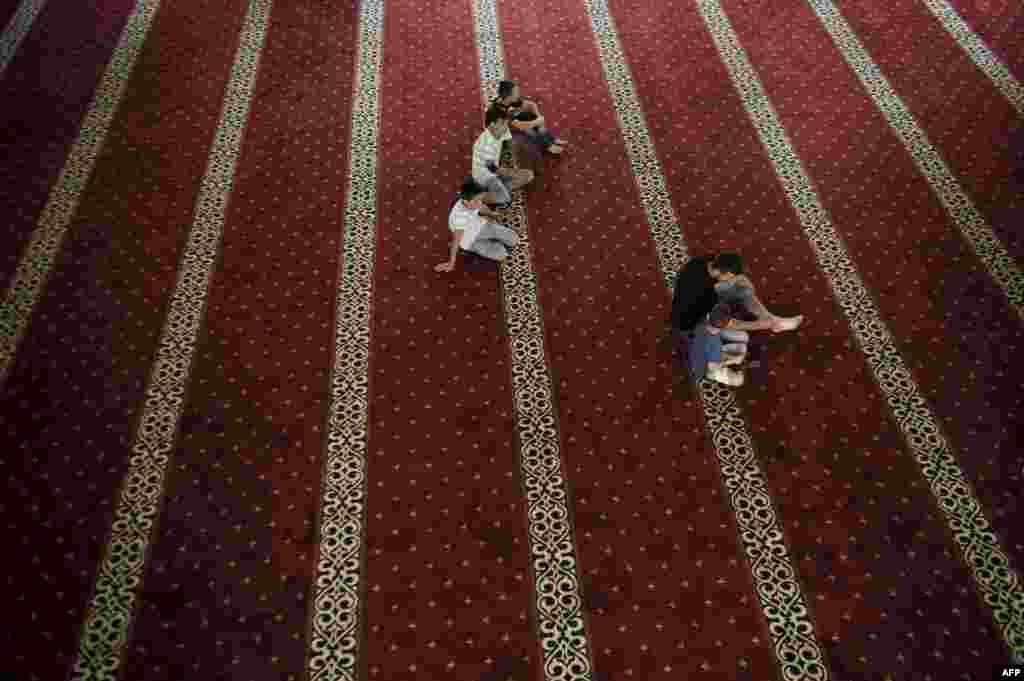 Muslims arrive for prayers at the newly constructed Bajram Pasha Isa Beg Mosque in the Kosovo town of Mitrovica on July 7,during the holy fasting month of Ramadan. (AFP/Armend Nimani)
