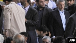The public got a seemingly rare glimpse of Mir Hossein Musavi (bottom center) at Friday Prayers on July 17.
