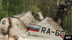 A rescuer walks amid the debris of the RusAir Tu-134 passenger jet at the crash site near Petrozavodsk.