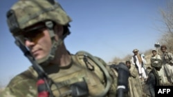 A U.S. soldier takes part in a foot patrol in Kandahar Province in early January.