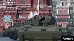 Russian Kurganets-25 armored personnel carriers drive during the Victory Day parade at Red Square in Moscow on May 9.