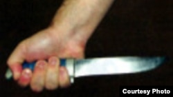 Tatarstan -- illustration photo - a hand holding knife