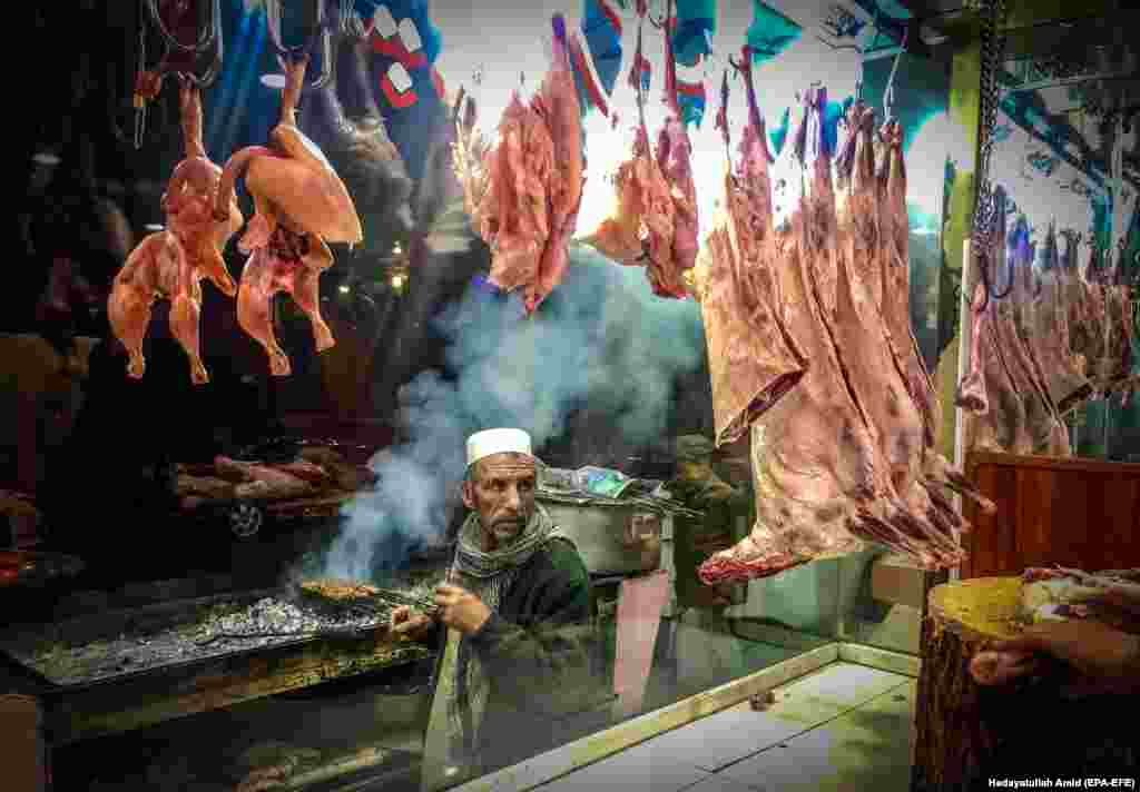 A man sells traditional grilled food at a shop in Kabul, Afghanistan. (epa-EFE/Hedayatullah Amid)