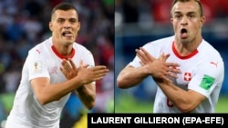 Switzerland players Granit Xhaka (left) and Xherdan Shaqiri making the eagle emblem of Albania during their World Cup game against Serbia.