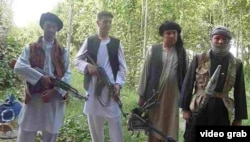 FILE: Members of an ethnic Turkmen anti-Talibn militia in northern Jawzjan Province.