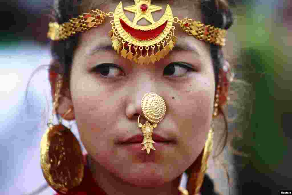 A woman wearing traditional ornaments participates in a parade in Kathmandu marking the 60th anniversary of the first ascent of Everest.