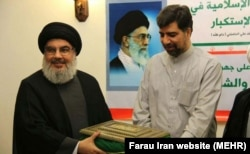Ghazanfar Roknabadi with Hezbollah Leader Hassan Nasrallah. (Undated)