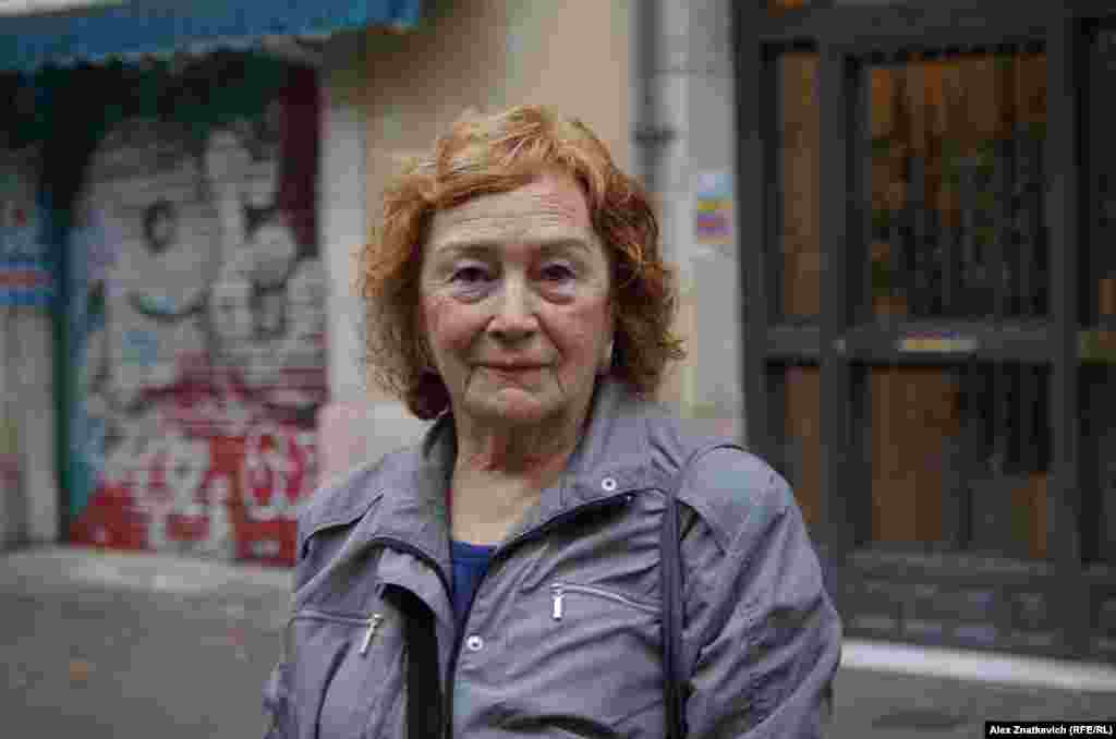"This woman agreed to be photographed, but declined to give her name. She said: ""We are being strangled. The Spanish government strangles us and takes our money."""