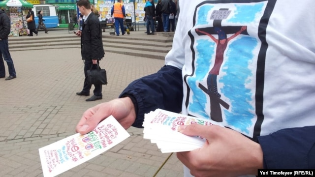 An activist hands out leaflets during an action in Moscow in support of Pussy Riot in 2012.