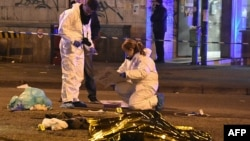 Italian police and forensics experts gather around the body of suspected Berlin truck attacker Anis Amri after he was shot dead in Milan on December 23.