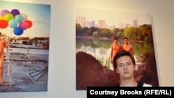 Russian-born photographerAlexander Kargaltsev stands in front of one of his portraits, of a gay couple posing in Central Park, at his exhibition launch on October 26.